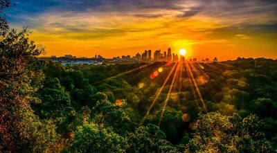 Sunset over downtown Austin, Texas, with Greenbelt in foreground